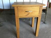 Solid oak bedside/ side table with one drawer. Excellent condition, hardly used.