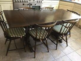 Ercol elm dining table and 6 chairs