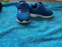 Kids Nike C5.5 running trainers.