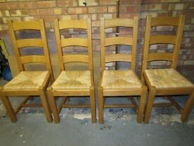 Beech dining chairs with raffia seating x 4