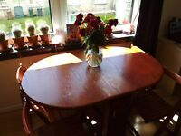 Vintage, folding table with 4 chairs on the wheels