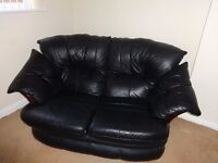 Two seater black leather sofa and two leather singles