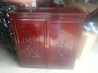 Lovely antique red wood cabinet with carvings & drawers
