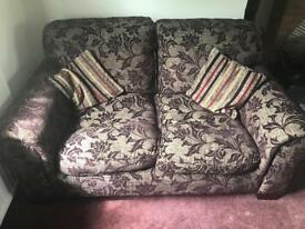 Must go ASAP - will consider offers. Sofa; purple and neutral floral 2 piece suite. Great condition