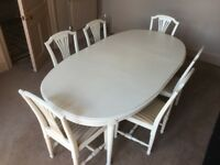 Contemporary cream table and six chairs