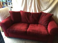 Red Sofa bed, subtle pattern, very good conditon