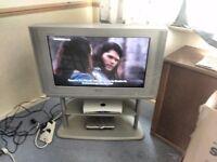 "Samsung 32"" flatscreen TV. Skyfreeviex box, dvd player and stand."