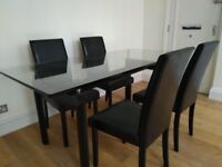 Dining glass table with four chairs