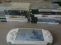 White Psp 1003 with 9 games and 3 films