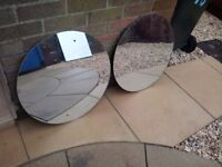 pair of large circular old mirrors