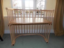 Babybay Co-sleeper Convertible Cot in Varnished Beech and in excellent condition.