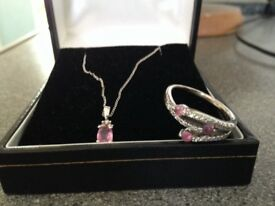 Gorgeous white gold open work ring with diamonds and pink stones with matching pendant