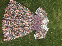 Baby dress, Nantucket Design for Children, floral pattern on black, lace collar and cuffs