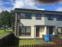 3 bed end terrace villa in Inverbreakie Drive, Invergordon. Garden front and rear with shed.