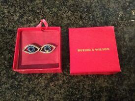 Butler & Wilson crystal eye cufflinks