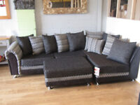 FABRIC BLACK CORNER SOFA IN PATTERN WITH FOOTSTOOL