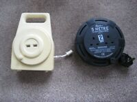 Two winding Extension Leads For Telephone And Electrical Power.