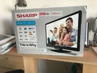 Sharp Freeview 24inch/60cm LED HD TV. Gently used in original packaging