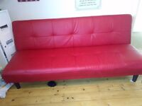 Faux leather red sofa bed. Immaculate condition. Collect Mansfield £55