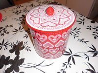 A red and white storage tin (Ideal for Christmas)