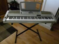 yamaha portable grand keyboard DGX 300 includes accessorsies data disc & owners manual