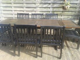Wooden garden table with 8 chairs