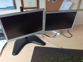 Two monitors on a VonHaus Triple Monitor Stand