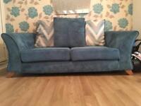 Stunning 2 seater turquoise sofa
