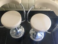 2 matching cream leather bar stools good condition