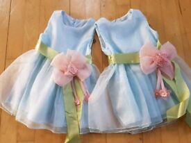 2 x beautiful chiffon dresses. Perfect for twins at a wedding. 12-18m