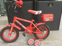 Boys red fire bike with stabilizers