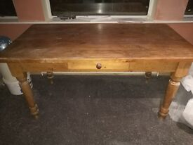 Pine dining table, good condition, 1.5m x 0.75m x 0.75m high.