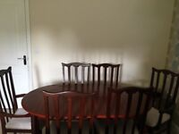 6 seater extendable dining table and chairs