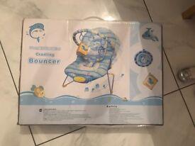 Blue reclining vibrating chair