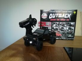 RC Outback Mini 4x4 crawler. USB charger remote and all batteries included . Led front headlights.