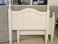 Solid white painted wooden single bed