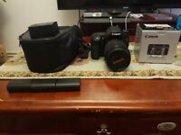 Canon 70d with 18-135mm and 50mm lenses plus extras