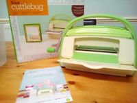 Cuttle bug with die cutters and embossing plates