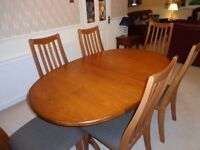 GPlan extending dining table & six chairs,immaculate condition £1500 new for sale £120 must collect.