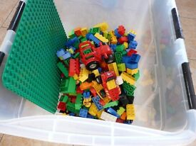 Duplo blocks including tractor and trailer, building base and figures