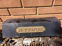 Outside newspaper holder