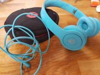 Light blue Beats headphones
