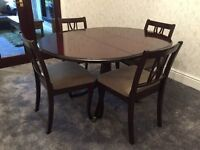 Strongbow Sheraton Solid Mahogany Circular Extending Dining Table and Four Chairs