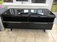 Black high gloss TV stand with two drawers.