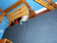 Pine highsleeper single bed with pull out bottom bed and desk area.