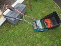 Small electric garden rake with box