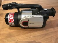 Canon XM1 camcorder with charger, capturing device and battery