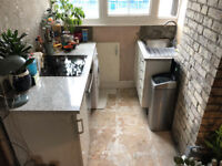 Kitchen worktop, washing maching, hob, oven, sink, and under-cabinets in good working order