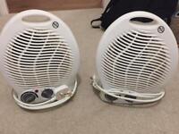 Two electric fan heaters