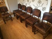 SIX VINTAGE OAK AND BROWN LEATHER CHAIRS